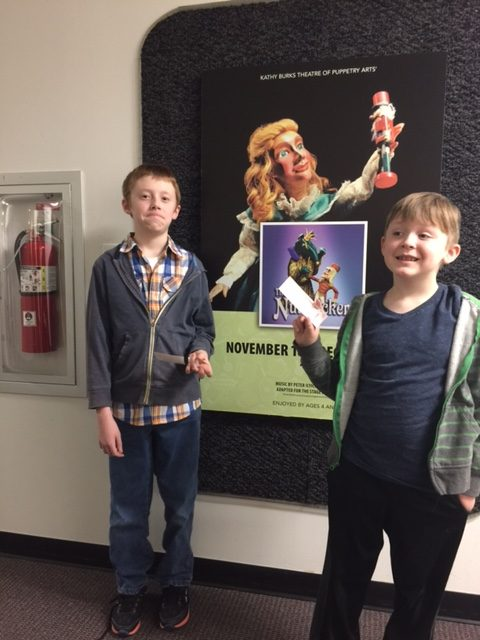 chris-and-adam-with-tix-to-the-nutcracker-please-crop-out-fire-extinguisher